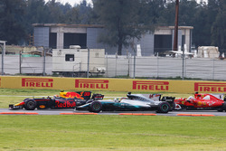 Max Verstappen, Red Bull Racing RB13, leads, Lewis Hamilton, Mercedes AMG F1 W08 and Sebastian Vette