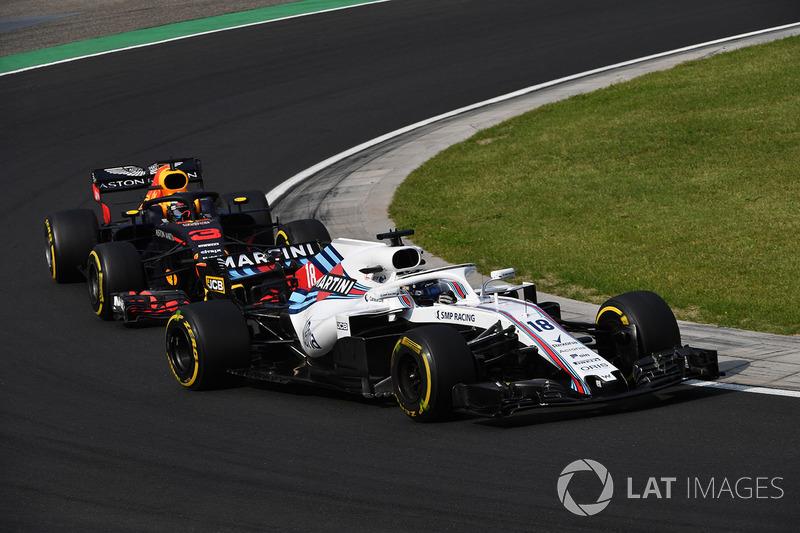 Lance Stroll, Williams FW41 y Daniel Ricciardo, Red Bull Racing RB14