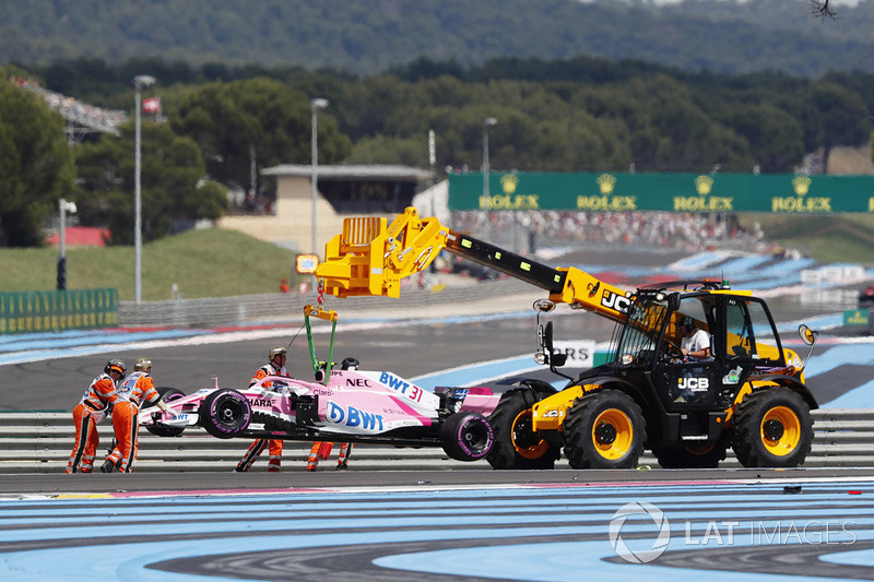 Esteban Ocon's Force India VJM11 is lifted by a crane