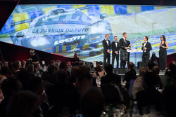WEC Champions Brendon Hartley, Timo Bernhard and Earl Bamber present the John Bolster award to Pierr