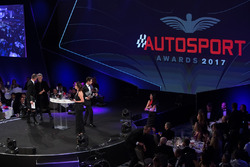 Lando Norris on stage to accept the National Driver of the Year Award from Eddie Jordan