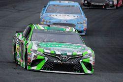 Kyle Busch, Joe Gibbs Racing Toyota, leads Kevin Harvick, Stewart-Haas Racing Ford