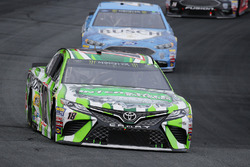 Kyle Busch, Joe Gibbs Racing Toyota, leads Kevin Harvick, Stewart-Haas Racing Ford