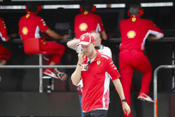 After crashing out, Sebastian Vettel, Ferrari, talks to Maurizio Arrivabene, Team Principal, Ferrari, and Jock Clear, Engineering Director, Ferrari