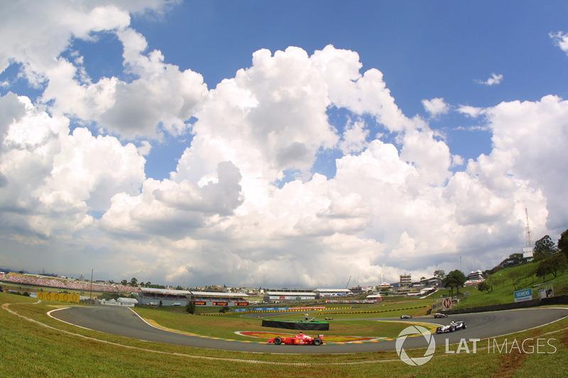 Podium: race winner David Coulthard, McLaren, second place Michael Schumacher, Ferrari F1