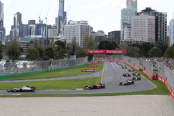 Kevin Magnussen, Haas F1 Team VF-18 leads Max Verstappen, Red Bull Racing RB14 at the start of the race
