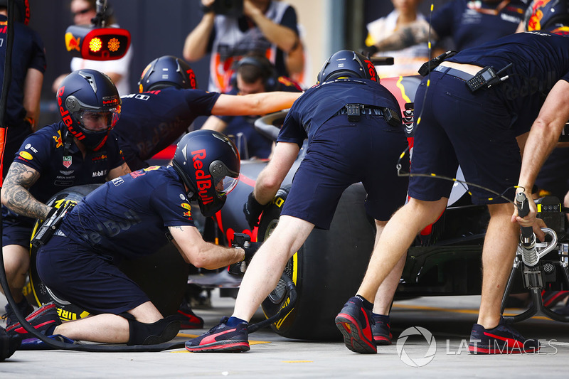 Red Bull engineers practice a pit stop