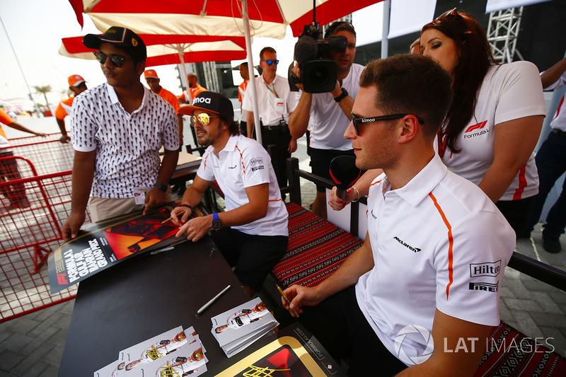 Fernando Alonso, McLaren, and Stoffel Vandoorne, McLaren, sign autographs