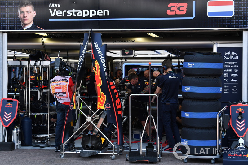 Red Bull Racing mechanics work on the car of Max Verstappen, Red Bull Racing RB14
