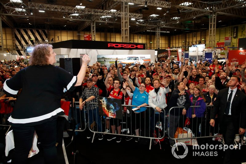 Ferrari merchanidse is thrown into the crowd in front of the Autosport stage