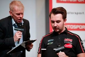 Presenter Alan Hyde talks to Tom Ingram on the Autosport stage