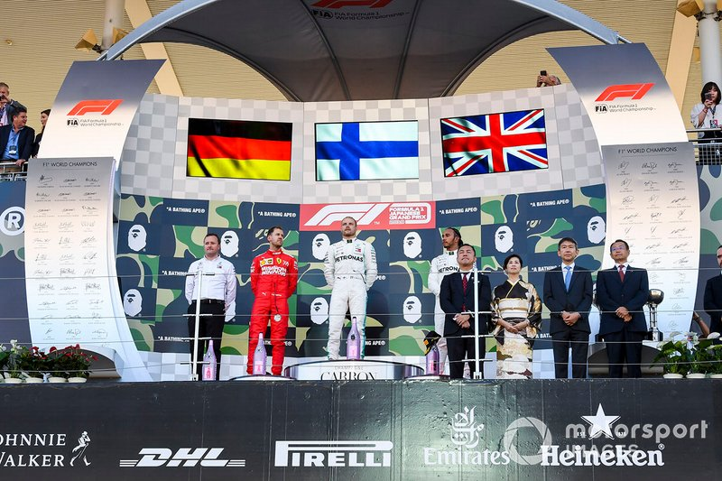 Eric Blandin, Chief Aerodynamicist, Mercedes AMG, Sebastian Vettel, Ferrari, 2nd position, Valtteri Bottas, Mercedes AMG F1, 1st position, and Lewis Hamilton, Mercedes AMG F, 3rd position, on the podium