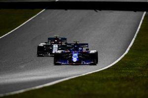 Pierre Gasly, Toro Rosso STR14, leads Antonio Giovinazzi, Alfa Romeo Racing C38