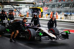 Romain Grosjean, Haas F1 Team VF-19, in the pit lane