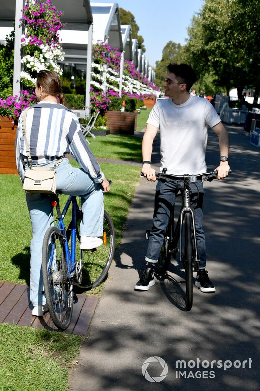 Charles Leclerc, Ferrari rides his bike in the circut with his girlfriend Charlotte Sine