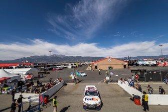 Denny Hamlin, Joe Gibbs Racing, Toyota Camry FedEx Office leaves the NASCAR Cup Series garage