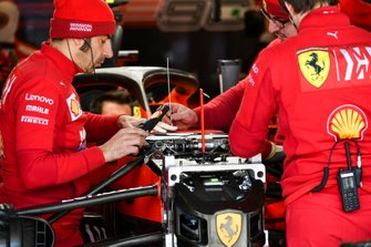 Ferrari mechanics at work in the garage