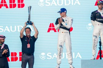 Michael Andretti, Chief Executive Officer & Chairman of Andretti Autosport lifts the winners' trophy on the podium