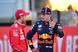 Sebastian Vettel, Ferrari, with Max Verstappen, Red Bull Racing