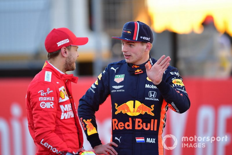 Sebastian Vettel, Ferrari, with Max Verstappen, Red Bull Racing