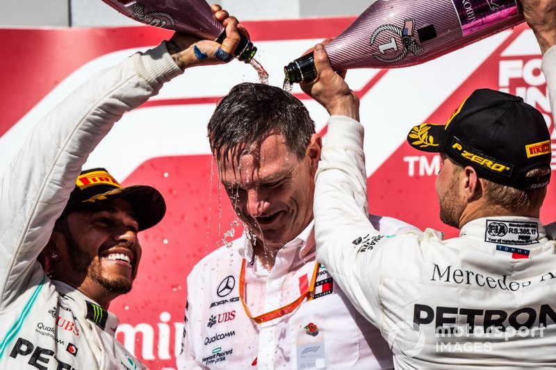 Lewis Hamilton, Mercedes AMG F1, 2nd position, and Valtteri Bottas, Mercedes AMG F1, 1st position, pour Champagne over James Allison, Technical Director, Mercedes AMG, on the podium