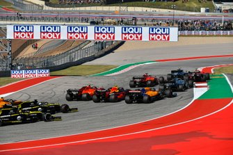 Valtteri Bottas, Mercedes AMG W10, leads Max Verstappen, Red Bull Racing RB15, Sebastian Vettel, Ferrari SF90, Lewis Hamilton, Mercedes AMG F1 W10, and Charles Leclerc, Ferrari SF90, as Alex Albon, Red Bull Racing RB15, and Carlos Sainz Jr., McLaren MCL34, make contact at the start