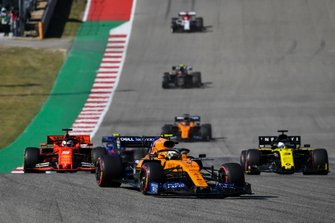 Lando Norris, McLaren MCL34, leads Sebastian Vettel, Ferrari SF90, Daniel Ricciardo, Renault F1 Team R.S.19, Carlos Sainz Jr., McLaren MCL34, and Kevin Magnussen, Haas F1 Team VF-19