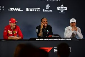 Sebastian Vettel, Ferrari, Race winner Lewis Hamilton, Mercedes AMG F1 and Valtteri Bottas, Mercedes AMG F1