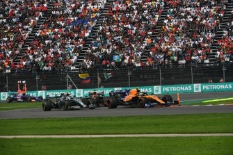 Lando Norris, McLaren MCL34, leads Valtteri Bottas, Mercedes AMG W10, and Max Verstappen, Red Bull Racing RB15