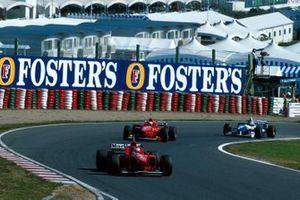 Michael Schumacher, Ferrari, Eddie Irvine, Ferrari F310, Jacques Villeneuve, Williams FW18
