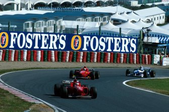 Michael Schumacher, Ferrari, Eddie Irvine, Ferrari F310, Jacques Villeneuve, Williams FW18