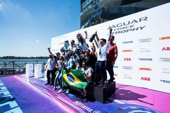 Race winner Sérgio Jimenez, Jaguar Brazil Racing celebrates with his team on the podium