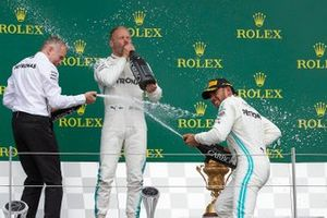 Valtteri Bottas, Mercedes AMG F1, 2nd position, and Lewis Hamilton, Mercedes AMG F1, 1st position, celebrate with Champagne