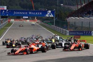 Charles Leclerc, Ferrari SF90, leads Sebastian Vettel, Ferrari SF90, Lewis Hamilton, Mercedes AMG F1 W10, Valtteri Bottas, Mercedes AMG W10 at the start of the race