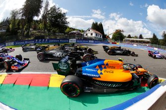 Lando Norris, McLaren MCL34, leads Kevin Magnussen, Haas F1 Team VF-19 Daniel Ricciardo, Renault F1 Team R.S.19, Romain Grosjean, Haas F1 Team VF-19, Nico Hulkenberg, Renault F1 Team R.S. 19 and Pierre Gasly, Toro Rosso STR14
