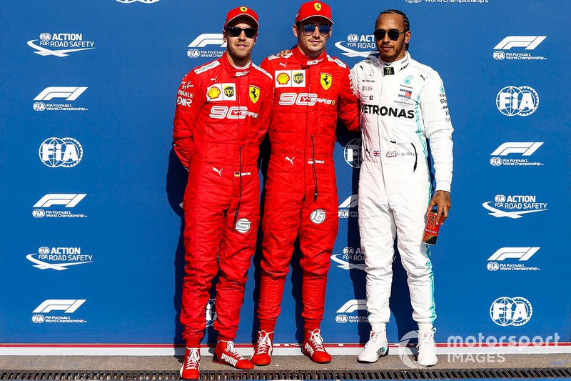 Charles Leclerc, Ferrari, celebrates pole position, with second place Sebastian Vettel, Ferrari, and third place Lewis Hamilton, Mercedes AMG F1