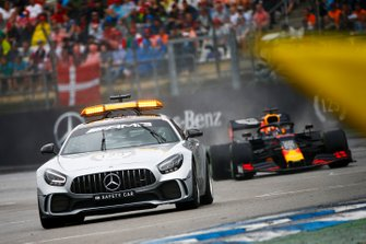 The Safety Car leads Max Verstappen, Red Bull Racing RB15