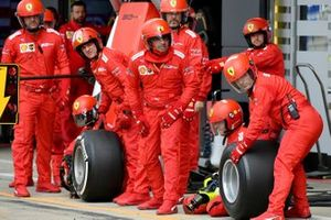 The Ferrari pit crew ready for a stop