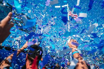 The DS TECHEETAH team celebrate below the podium