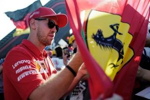 Sebastian Vettel, Ferrari signs an autograph for a fan
