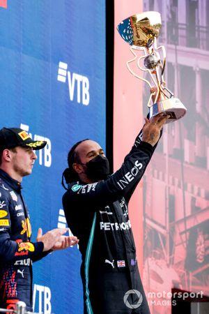 Lewis Hamilton, Mercedes, 1st position, lifts the winners trophy