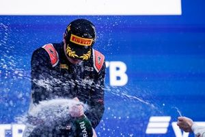 Dan Ticktum, Carlin, 1st position, celebrates with Champagne on the podium