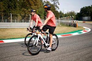 Max Verstappen, Red Bull Racing RB16B Sergio Perez, Red Bull Racing RB16B track walk on bicycles