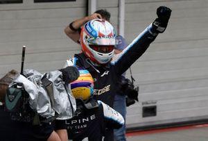 Fernando Alonso, Alpine F1, and Esteban Ocon, Alpine F1, 1st position, celebrate together