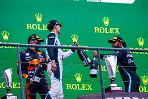 George Russell, Williams, 2nd position, and Lewis Hamilton, Mercedes, 3rd position, congratulate each other on the podium