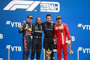 Max Verstappen, Red Bull Racing, 2nd position, the Mercedes team rpresentative, Lewis Hamilton, Mercedes, 1st position, and Carlos Sainz Jr., Ferrari, 3rd position, on the podium
