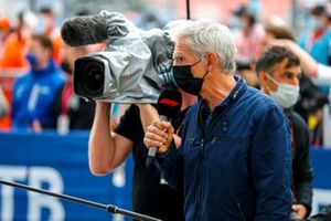 Damon Hill conducts interviews in Parc Ferme after the race
