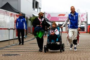 Nikita Mazepin, Haas F1, in the paddock with a young guest