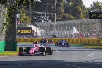Lance Stroll, Racing Point RP19, leads Daniil Kvyat, Toro Rosso STR14, and Pierre Gasly, Red Bull Racing RB15