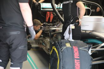 Team member at work on the Mercedes AMG F1 W10